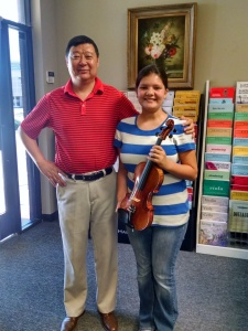 Adana wth Mr. Kelin Zheng, who made her violin